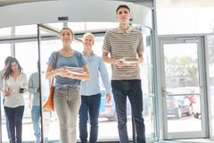Students in university entrance. Walk together as freshman Stock Image