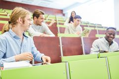 Students at university lecture Royalty Free Stock Photos