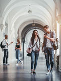 Students in university. Multiracial students are walking in university hall during break and communicating Stock Photography