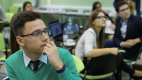Students at the university. Young and promising students on practical training in the classroom. They carefully look at