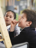 Students Using Abacus In Classroom Stock Photography