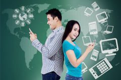 Students using cellphone with futuristic interface Royalty Free Stock Photography