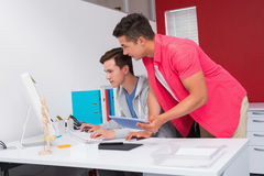 Students using computer and tablet together Royalty Free Stock Image