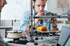 Students using a 3D printer royalty free stock photos