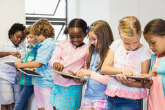Students using digital tablet in classroom. At elementary school Royalty Free Stock Photos