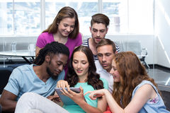 Students using digital tablet. Portrait of college students using digital tablet Royalty Free Stock Photography