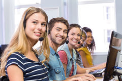 Students using headsets in computer class Stock Photos