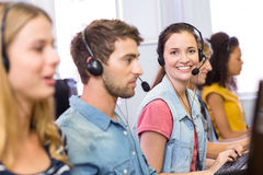 Students using headsets in computer class Royalty Free Stock Images