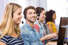 Students using headsets in computer class Stock Photography