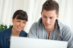 Students using a laptop Royalty Free Stock Images