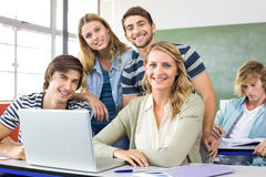 Students using laptop in classroom. Group of students using laptop in classroom Royalty Free Stock Photos