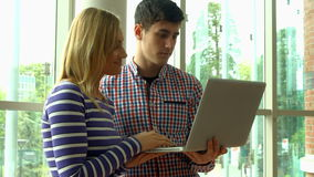 Students using laptop in college. In high quality 4k format stock video footage