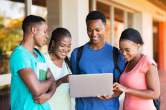 Students using laptop. Group of modern african university students using laptop Royalty Free Stock Photography