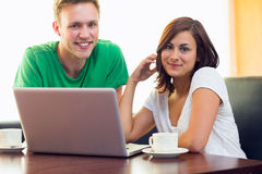 Students using laptop while having coffee at  coffee shop Royalty Free Stock Photography
