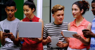 Students using laptop, mobile phone and digital tablet stock video