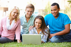 Students using laptop outdoors Stock Images