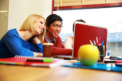 Students using laptop together Royalty Free Stock Images
