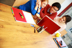 Students using laptop together Stock Image