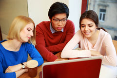 Students using laptop together Stock Photos