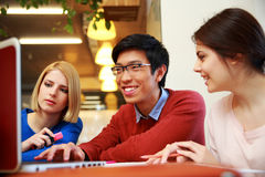 Students using laptop together Stock Images