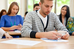 Students using phones royalty free stock image