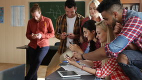 Students using smart phone sitting desk university classroom stock footage