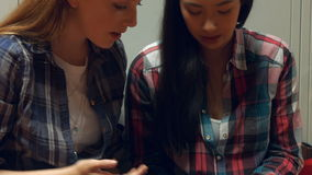 Students using a smart phone together stock video footage