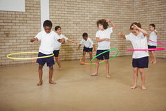 Students using some hula hoops Stock Photography
