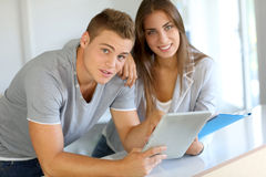 Students using tablet Royalty Free Stock Photos