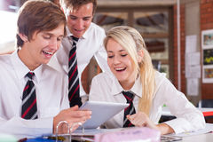 Students using tablet computer Stock Images