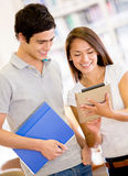 Students using a tablet computer Stock Image