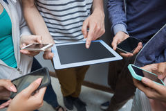 Students using tablet pc and their smartphones Stock Photos