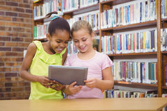 Students using a tablet pc together Royalty Free Stock Photo