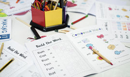Students vocabulary coloring workbook all around the table royalty free stock photography