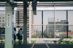 Students waiting subway on platform in Japan. NAGASAKI, JAPAN - May 25, 2015 : students waiting subway on platform Stock Photo