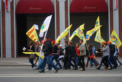 Students walk holding yellow flags. Royalty Free Stock Photography