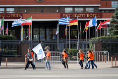 Students walk by the President hotel in Moscow. Royalty Free Stock Photography