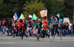 Students walk on the street, they participate in the parade. Royalty Free Stock Photography