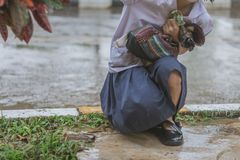 Students walk to the flood. After rain in school Royalty Free Stock Image