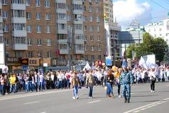 Students walk on Yakimanka street in Moscow Royalty Free Stock Photo