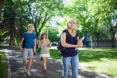 Students Walking on Campus Royalty Free Stock Images