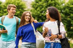 Students walking in a city. Group of multi ethnic students walking in a city Royalty Free Stock Photo