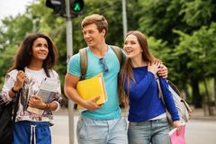 Students walking in a city Royalty Free Stock Images