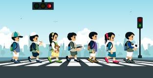Students walking on a crosswalk Stock Photography