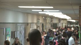 Students walking down hall by lockers (13 of 16) stock footage