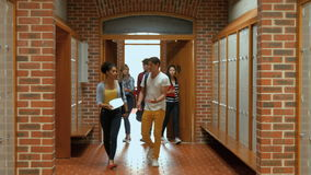 Students walking down hallway to locker stock video footage
