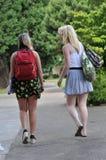 Students walking in front of school Stock Photos