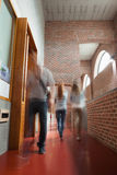 Students walking through hallway away from camera Royalty Free Stock Photography