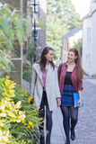 Students Walking Through the Street Stock Photography