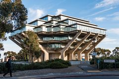 Students Walks By the Geisel Library at UCSD. LA JOLLA, CALIFORNIA - FEBRUARY 17, 2018:  Student walks by the Geisel Library at University of California San Stock Photography